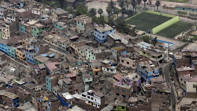In this Nov. 5, 2012 photo, homes cover the Rimac neighborhood of Lima, Peru. Seismologists, engineers and civil defense officials agree that Lima is due for an earthquake but is acutely vulnerable and sorely unprepared. More than two in five of capital residents inhabit rickety structures built on unstable, sandy soil and wetlands, which amplify a quake's destructive power, or in the hillside settlements ringing the capital that sprang up spontaneously over a generation as people fled conflict and poverty in the interior, experts say.  (AP Photo/Rodrigo Abd)