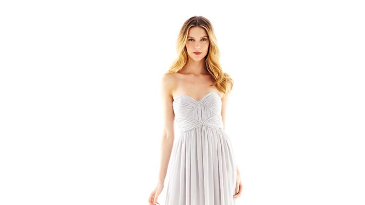 This product image released by J.C. Penney shows a strapless rhinestone trim dress from Pearl by Georgina Chapman of Marchesa.  Chapman, designer of red-carpet favorite Marchesa, is now offering a significantly less expensive version of her party looks at J.C. Penney under the Pearl label. (AP Photo/J.C. Penney)