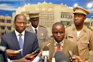 Burkina Faso&#39;s Foreign Minister Djibril Bassole (L) listens as members of Mali&#39;s junta delegation Colonel Moussa Coulibaly, Captain Adama Diarra (2ndL) and junta spokesman Lieutenant Amadou Konare (R) speak to the press in Ouagadougou. The junta&#39;s envoys promised to work towards restoring constitutional order
