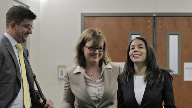 Fox television reporter Jana Winter, right, and her attorneys arrive at district court for a hearing for Aurora theater shooting suspect James Holmes in Centennial, Colo., on Wednesday, April 10, 2013. Winter was subpoenaed to testify in Colorado about who gave her confidential information about a notebook James Holmes sent to his psychiatrist days before he allegedly opened fire on a crowded movie theater last July, killing 12 people.  (AP Photo/Ed Andrieski)