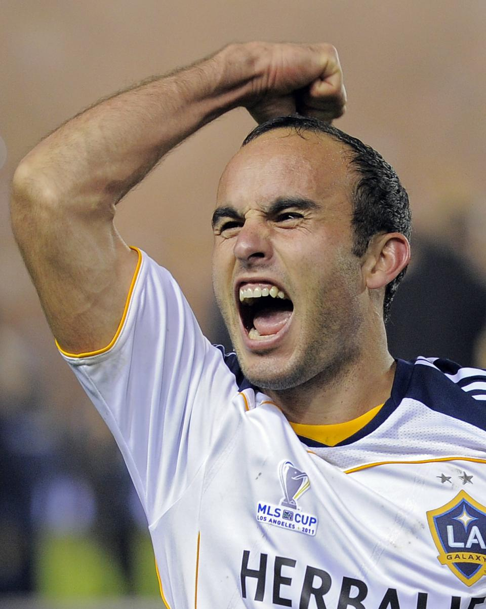 Los Angeles Galaxy forward Landon Donovan celebrates after they won their MLS Cup championship soccer match against the Houston Dynamo, Sunday, Nov. 20, 2011, in Carson, Calif. The Galaxy won 1-0.  (AP Photo/Mark J. Terrill)