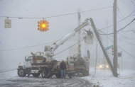 Fog shrouds work crews repairing down power lines Wednesday, Feb. 27, 2013 at 8 mile and Five points, in Southfield, Mich. The storm that hit the nation&#39;s midsection dropped at least 7 inches of snow on parts of Michigan and created dangerous driving conditions. (AP Photo/The Detroit News, Daniel Mears) DETROIT FREE PRESS OUT; HUFFINGTON POST OUT