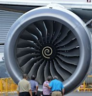 "Visitors are seen next to an engine of a Boeing 787 Dreamliner, displayed at the Singapore Airshow, on February 12. Boeing said around 55 of its flagship 787 Dreamliners ""have the potential"" to develop a fuselage shimming problem, but reiterated that the fault was being fixed"