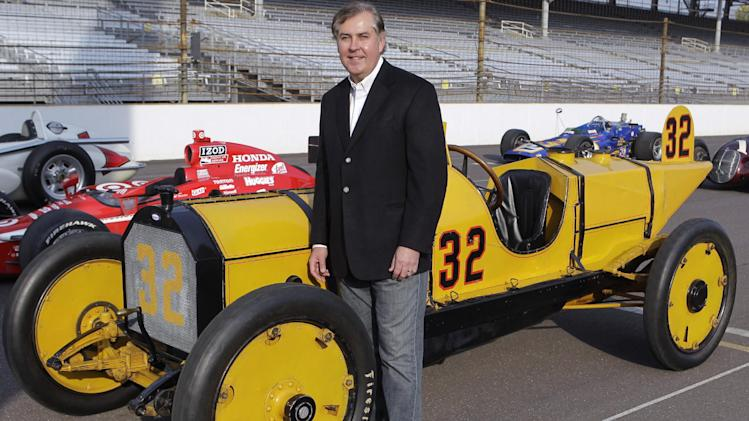 In this Oct. 12, 2012, photo, Indianapolis Motor Speedway President Jeff Belskus poses with 1911 Marmon Wasp, driven by Ray Harroun in the first Indianapolis 500 race, during a photo session at the speedway in Indianapolis. It's business as usual for the IndyCar Series, which is staying the course set by former CEO Randy Bernard. Only the series will be led for now by Jeff Belskus. Belskus reiterated Thursday, Nov. 1, 2012, that IndyCar is not for sale and the Hulman-George family believes in the future of the series. Belskus spoke at length for the first time since Bernard's three-year run came to an end following Sunday night's emergency meeting of the IMS board of directors. It was called after a frenzied month of speculation about Bernard's future. (AP Photo/Michael Conroy)