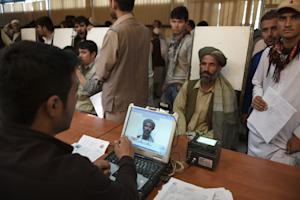 An Afghan man has his photograph taken for facial biometric …