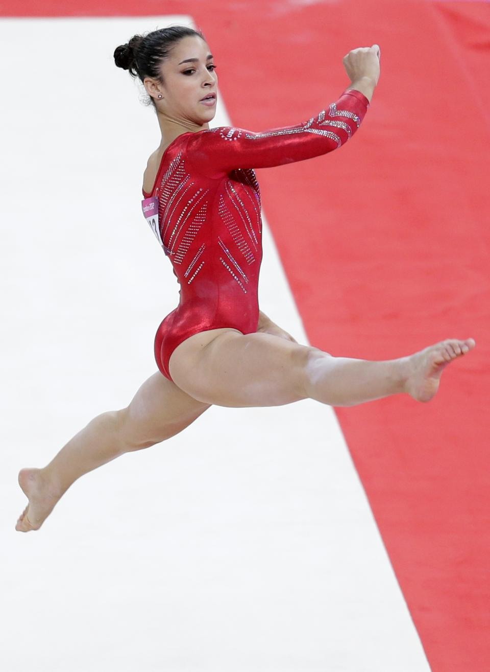 U.S. gymnast Alexandra Raisman performs on the floor during the Artistic Gymnastic women's team final at the 2012 Summer Olympics, Tuesday, July 31, 2012, in London. (AP Photo/Gregory Bull)