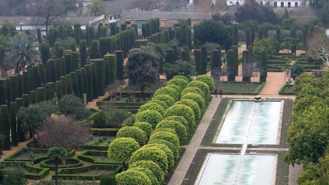 This Jan. 12, 2013 photo taken in Cordoba, in Andalusia, Spain, shows the grounds of a 14th-century royal residence, the Alcazar, featuring Islamic garden motifs, from citrus trees to the centrality of water. Andalusia offers a fusion of Christian and Islamic cultures, found in architectural masterpieces and in everyday life. (AP Photo/Giovanna Dell'Orto)