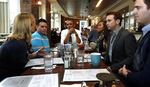 U.S. President Barack Obama has lunch with five supporters of Obamacare at The Coupe restaurant in Washington