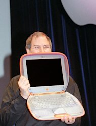 Interim chief executive of Apple Computer Steve Jobs the Power Mac iBook G3 in Paris on September 15, 1999