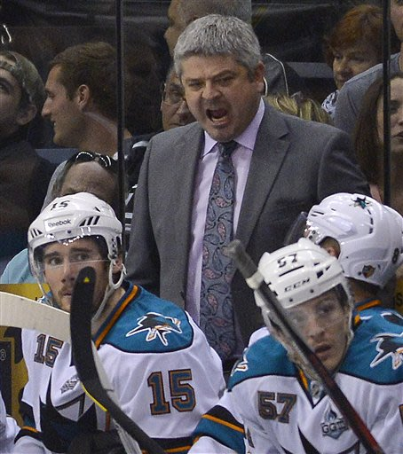 San Jose Sharks coach Todd McLellan reacts as he watches against the Los Angeles Kings during the third period in Game 5 of the Western Conference semifinals in the NHL hockey Stanley Cup playoffs, Th