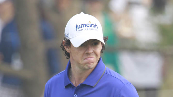 Rory McIlroy of Northern Ireland reacts after missing a birdie shot on the 9th fairway during the final round of the Masters golf tournament in Shanghai, China on Sunday Oct. 28, 2012. (AP Photo/Eugene Hoshiko)