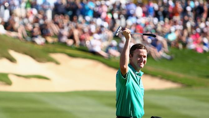 Jimmy Walker celebrates after making his putt on the 18th hole to win the final round of the Valero Texas Open on March 29, 2015 in San Antonio