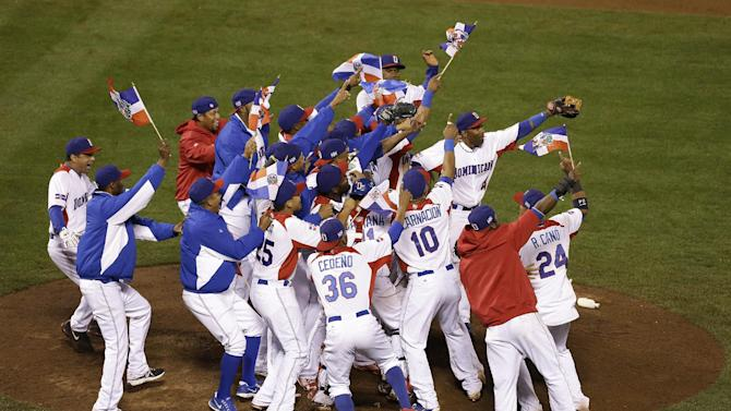The Dominican Republic players celebrate after beating Puerto Rico in the championship game of the World Baseball Classic in San Francisco, Tuesday, March 19, 2013. The Dominican Republic won 3-0. (AP Photo/Jeff Chiu)