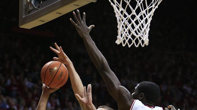 Jacksonville's Kordario Fleming (23) puts up a shot against Indiana's Derek Elston and Hanner Mosquera-Perea (12) during the first half of an NCAA college basketball game Friday, Dec. 28, 2012, in Bloomington, Ind. (AP Photo/Darron Cummings)