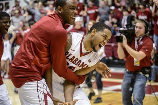 Releford's 3 lifts Alabama past Georgia 61-58