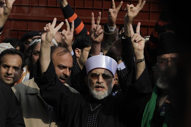 Pakistani Sunni Muslim cleric Tahir-ul-Qadri, 61, center, leaves Lahore to lead an anti-government march to the capital Islamabd, Pakistan, Sunday, Jan 13, 2013 in Pakistan. After years in Canada, Qad