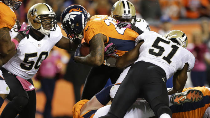 Denver Broncos running back Willis McGahee (23) crosses the goal line for a touchdown against the New Orleans Saints in the first quarter of an NFL football game, Sunday, Oct. 28, 2012, in Denver. (AP Photo/Jack Dempsey)