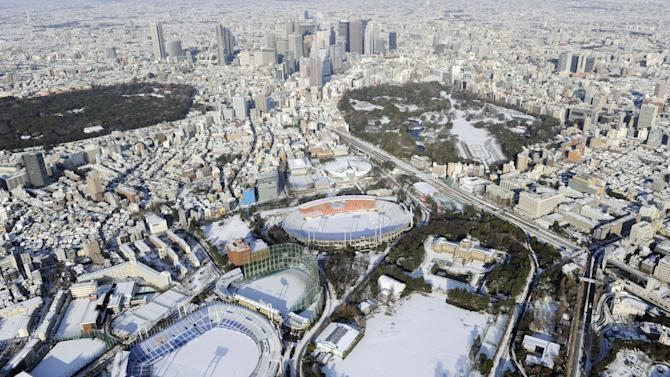 The center of town is still covered with snow in Tokyo Tuesday, Jan. 15, 2013 following Monday's snowfall. In the season's first snowfall in the Japanese capital, about 8 centimeters (3 inches) of snow fell in central Tokyo and around Narita on Monday - a national holiday in Japan. The snow snarled traffic and caused train delays. (AP Photo/Kyodo News) JAPAN OUT, MANDATORY CREDIT, NO LICENSING IN CHINA, HONG KONG, JAPAN, SOUTH KOREA AND FRANCE