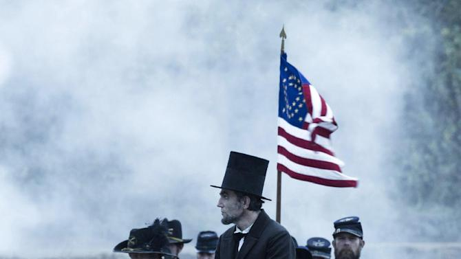 "This undated publicity photo provided by DreamWorks and Twentieth Century Fox shows Daniel Day-Lewis as President Abraham Lincoln looking across a battlefield in the aftermath of a terrible siege in this scene from director Steven Spielberg's drama ""Lincoln"" from DreamWorks Pictures and Twentieth Century Fox. Steven Spielberg has extended his domination at the Directors Guild of America Awards, earning his 11th film nomination Tuesday, Jan. 8, 2013, for his Civil War epic ""Lincoln."" (AP Photo/DreamWorks, Twentieth Century Fox, David James, File)"