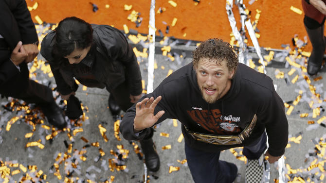 San Francisco Giants right fielder Hunter Pence waves while walking off the stage following a World Series baseball victory celebration at City Hall, Friday, Oct. 31, 2014, in San Francisco. San Francisco became the Valley of the Giants for the third time in five years as tens of thousands of people lined the streets for a confetti and rain-soaked parade honoring the city's World Series champions. (AP Photo/Eric Risberg)