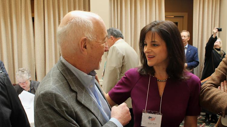 In this March 19, 2014 photo, Oregon Republican Senate candidate Monica Wehby, right, talks to supporter Marvin Hausman in Lake Oswego, Ore. Republicans are making a bold play for a U.S. Senate seat in Oregon, a reliably Democratic state that hasn't elected a Republican to a statewide office in more than a decade. Republicans think they've found the right candidate in Wehby, a children's brain surgeon who's raised more than $1 million and put her early opposition to the president's health law at the center of her campaign to help her party regain a Senate majority. (AP Photo/Jonathan J. Cooper)