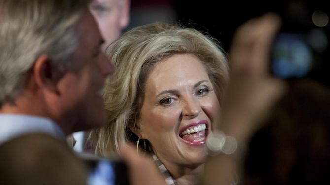 Ann Romney, wife of Republican Presidential candidate Mitt Romney, shakes hands with supporters after speaking at the Pinnacle Center in Hudsonville, Mich. on Friday, Oct. 12, 2012. (AP Photo/The Grand Rapids Press, Cory Morse)