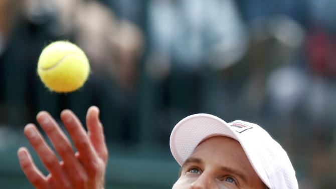 Andreas Seppi of Italy serves to John Isner of the U.S. during their men's singles match at the French Open tennis tournament at the Roland Garros stadium in Paris