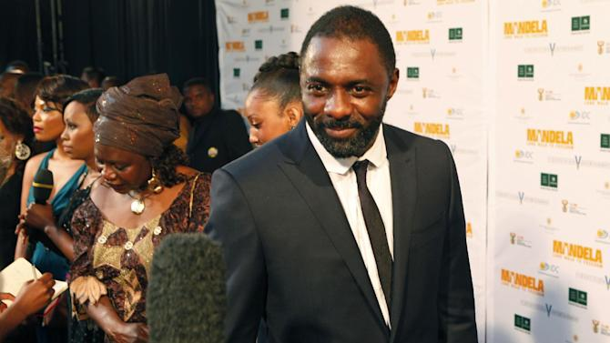 British Actor Idris Elba, who stars as Nelson Mandela, arrives at the South African premier of the film Mandela - Long Walk To Freedom, in Johannesburg, Sunday Nov. 3, 2013. The biographical film directed by Justin Chadwick, is based on South African President Nelson Mandela's autobiography of the same name, which chronicles his early life, coming of age, education and 27 years in prison before becoming President and working to rebuild the country's once segregated society. (AP Photo/Denis Farrell)