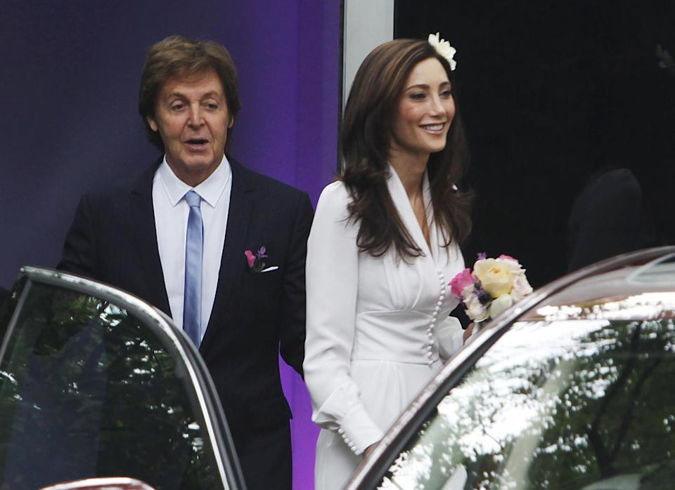Nancy Shevell with Sir Paul McCartney leave his house in the St. John's Wood neighborhood of London, to get married at nearby Marylebone Town Hall, Sunday Oct. 9, 2011. (AP Photo / David Parry, PA) UNITED KINGDOM OUT - NO SALES - NO ARCHIVES