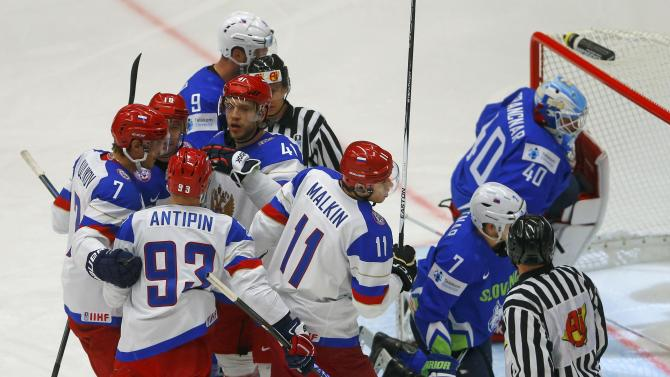 Russia's Kulyomin celebrates his goal against Slovenia with team mates during their Ice Hockey World Championship game at the CEZ arena in Ostrava