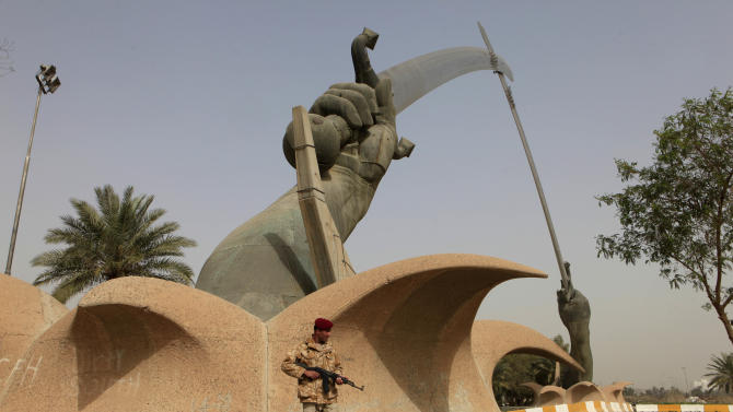 In this March 7, 2013 photo, an Iraqi soldier stands guard at the crossed-swords monument in Baghdad, Iraq. nside the fortified Green Zone that is home to the sprawling U.S. Embassy and several government offices, the crossed-sword archways Saddam commissioned during Iraq's nearly 8-year fight with Iran ground stand defiantly on a little-used parade ground. Iraqi officials began tearing them down in 2007, but quickly halted those plans and then started restoring the monument two years ago.(AP Photo/Karim Kadim)