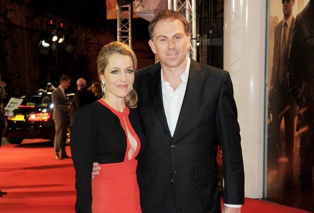 Gillian Anderson and Mark Griffiths attend the UK Premiere of 'Mission: Impossible Ghost Protocol' at BFI IMAX in London on December 13, 2011 -- Getty Premium