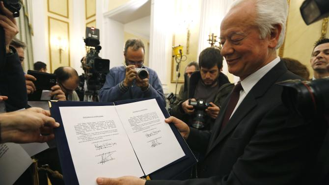 A presidential aide displays the papers appointing Syriza party leader Tsipras as Greece's first leftist prime minister after his swearing-in ceremony in Athens