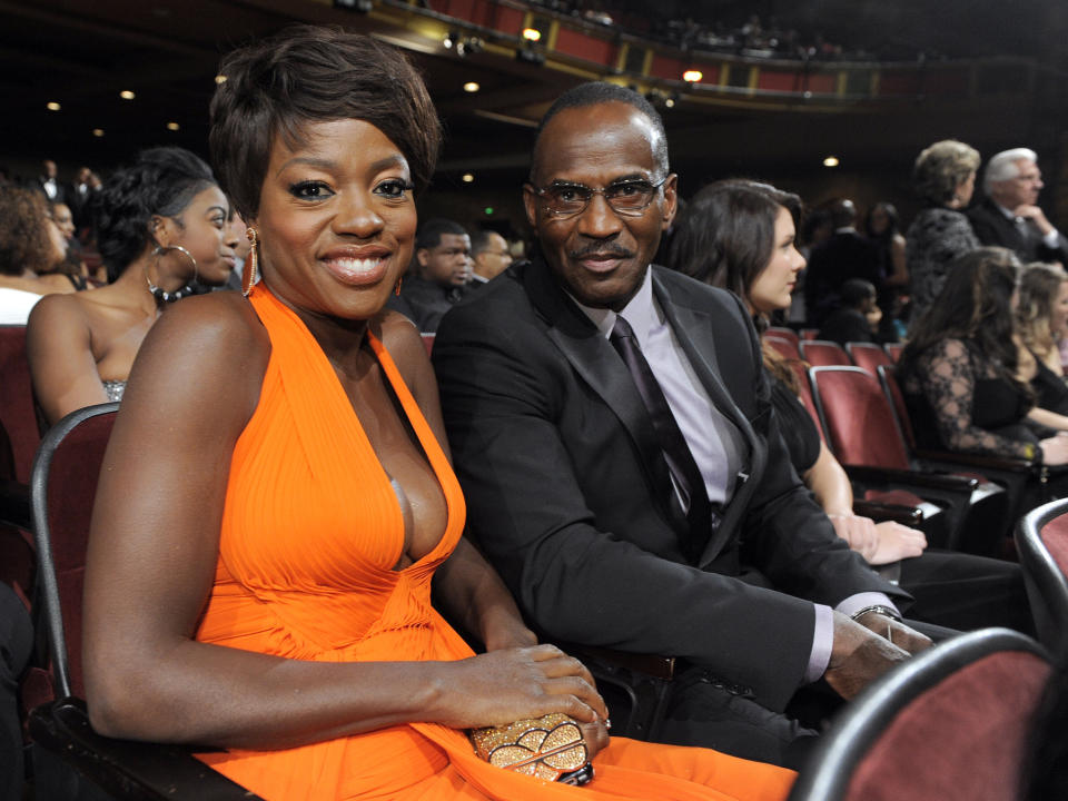 Viola Davis, left, and Julius Tennon pose in the audience at the 43rd NAACP Image Awards on Friday, Feb. 17, 2012, in Los Angeles. (AP Photo/Chris Pizzello)