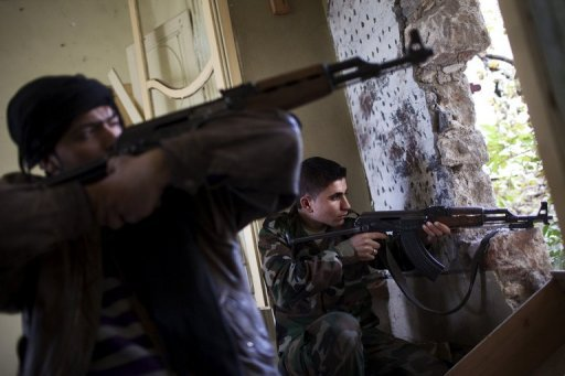 <p>Rebel fighters aim their weapons at regime forces on the front line in the old city of Aleppo on December 21, 2012. Representatives of the six oil-rich Gulf Cooperation Council states called in a joint statement on Tuesday for a rapid political transition in war-torn Syria.</p>