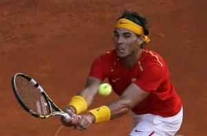 Spain's Nadal hits a return to Ukraine's Stakhovsky during their Davis Cup World Group playoff tennis tie in Madrid
