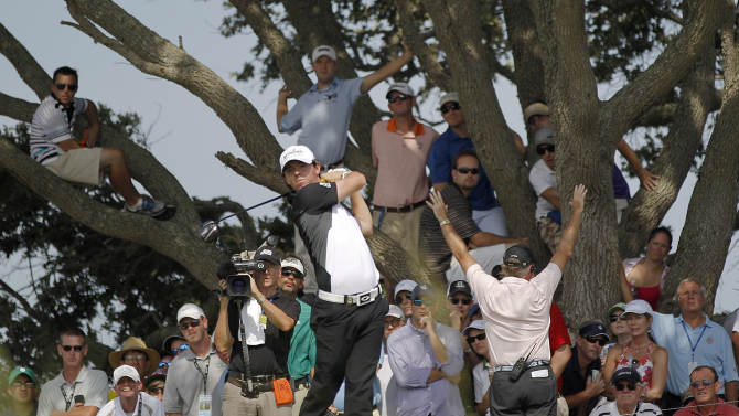 Rory McIlroy of Northern Ireland watches his drive from the seventh tee as fans watch from the trees during the third round of the PGA Championship golf tournament on the Ocean Course of the Kiawah Island Golf Resort in Kiawah Island, S.C., Saturday, Aug. 11, 2012. (AP Photo/Evan Vucci)
