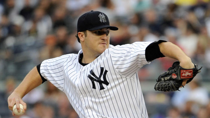 New York Yankees starting pitcher Phil Hughes throws against the New York Mets in the first inning of an interleague baseball game on Saturday, June 9, 2012, at Yankee Stadium in New York. (AP Photo/Kathy Kmonicek)