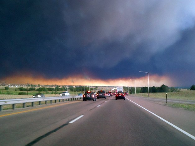 Colorado Springs resident Kim Marie took this photo, on I-25 near Castle Rock, while driving toward the Waldo Canyon fire on Tuesday. The fire has burned more than 16,000 acres and killed two people.