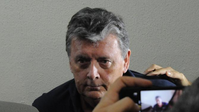 The CEO of Match Hospitality, a subsidary company of FIFA in charge of World Cup ticket packages, Raymond Whelan sits at a police station in Rio de Janeiro after being arrested on July 7, 2014