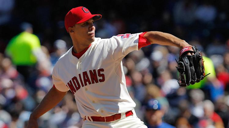 Cleveland Indians starter Ubaldo Jimenez throws during the second inning against the Toronto Blue Jays in a baseball game in Cleveland on Saturday,  April 7, 2012.  (AP Photo/Amy Sancetta)