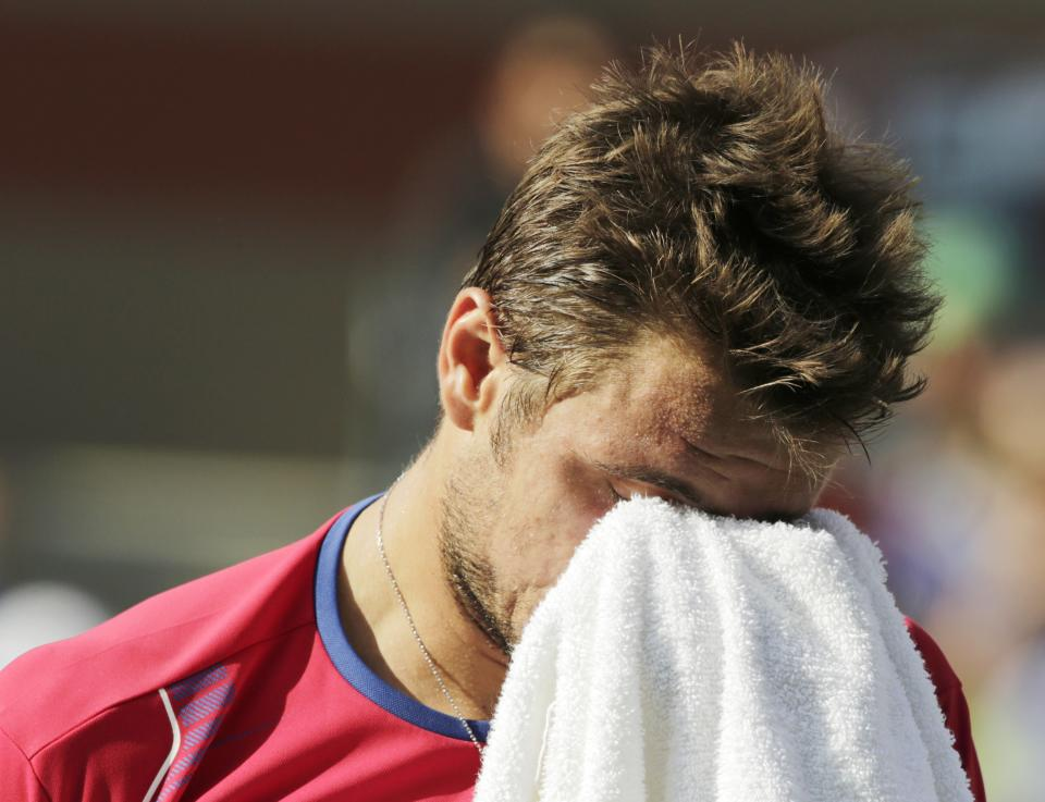 Stanislas Wawrinka, of Switzerland, wipes sweat from his eyes between points in the fifth set against Novak Djokovic, of Serbia, during the semifinals of the 2013 U.S. Open tennis tournament, Saturday, Sept. 7, 2013, in New York. (AP Photo/Charles Krupa)