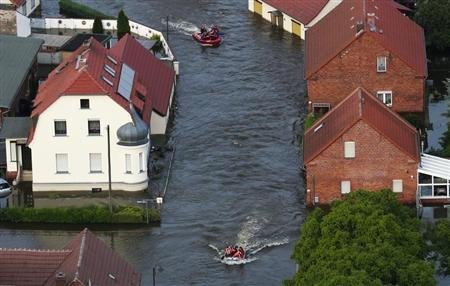 DLRG boats evacuate people from village of Fischbeck after it was flooded by Elbe river
