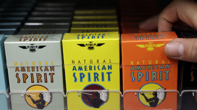 FILE - In this Tuesday, Feb. 1, 2011 file photo, Reynolds American cigarette brand American Spirit are on display at a liquor store in Palo Alto, Calif. A subsidiary of the nation's second-largest cigarette maker Reynolds American Inc. is funding a national recycling program to reward do-gooders for cleaning up tobacco waste and turn cigarette butts into pellets used to make items such as plastic shipping pallets, railroad ties and park benches. (AP Photo/Paul Sakuma, File)