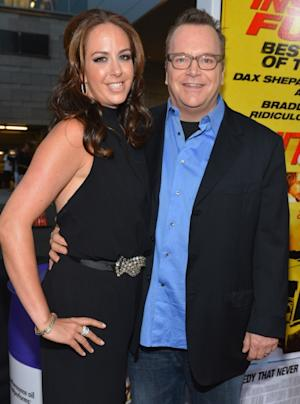 Ashley Groussman and Tom Arnold arrive to the premiere of Open Road Films' 'Hit and Run' on August 14, 2012 in Los Angeles -- Getty Images