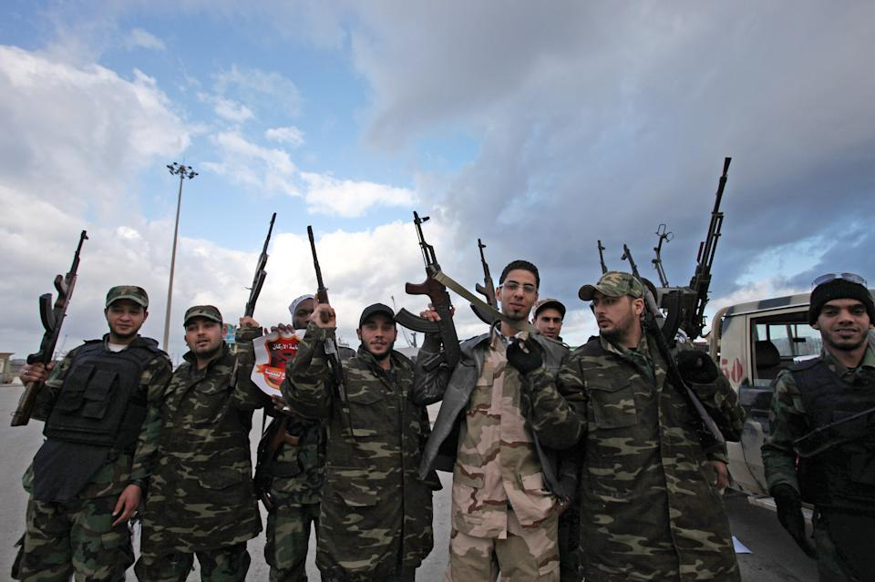 Libyan gunmen celebrate on the early morning of the second anniversary of the revolution that ousted Moammar Gadhafi, in Benghazi, Libya, Sunday, Feb, 17 2013.  (AP Photo/Mohammad Hannon)