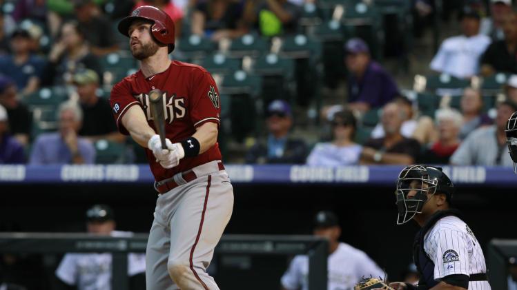 Davidson hits 3-run homer, D-backs beat Rox 13-9