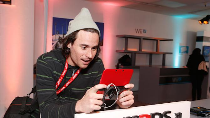 IMAGE DISTRIBUTED FOR NINTENDO OF AMERICA - Luis A. from Paraguay enjoys New Super Mario Bros. 2 on the Nintendo 3DS XL hand-held system while attending the Nintendo Lounge during the Sundance Film Festival in Park City, Utah on Monday, Jan. 21, 2013. From Professor Layton and the Miracle Mask to the yet-to-be-released Luigiís Mansion: Dark Moon, Nintendo has something for everyone.  (Photo by Todd Williamson/Invision for Nintendo of America/AP Images)