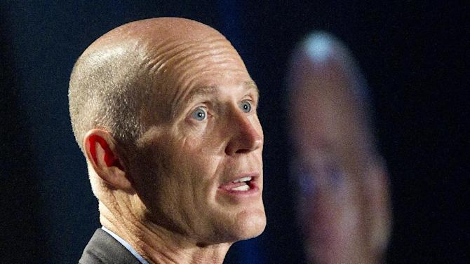 FILE - In this May 16, 2012 file photo, Florida Gov. Rick Scott speaks in Fort Lauderdale. Republican governors who've balked at creating new consumer health insurance markets under President Barack Obama's health care law may end up getting stuck.  Instead of their state officials retaining some control over insurance issues that states traditionally manage, Washington could be calling the shots.   (AP Photo/J Pat Carter, File)
