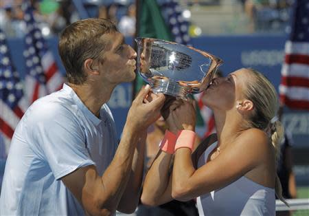 Hlavackova of the Czech Republic and Mirnyi of Belarus kiss their trophy after defeating Spears of the U.S. and Gonzalez of Mexico in the mixed doubles final at the U.S. Open tennis championships in New York